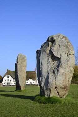 Neolithic megaliths and Red Lion Pub, Avebury Stone Circle, Wiltshire, UK, February 2014.