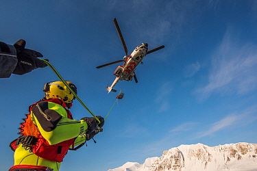 Search and Rescue helicopter winter training in Bellsund, Svalbard, Norway, March.