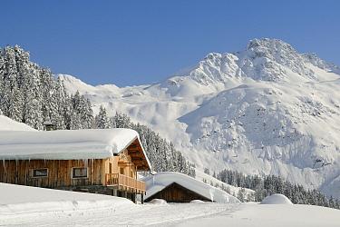 Alpine chalet and landscape after fresh snow, Hauteluce, Savoie, France, February 2013.