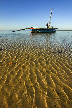 Men prepare their dhow for a late-morning fishing trip off the coast of Mossuril, northern Mozambique. June 2011