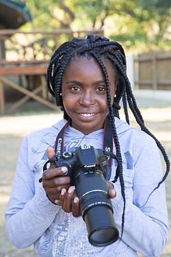 Pupil Tharollo Shaai with DSLR camera during residential photography course organised by Wild Shots Outreach. Kruger National Park, South Africa, June 2017.