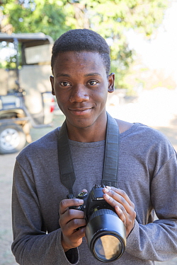 Pupil Chris Mojela with DSLR camera during residential photography course organised by Wild Shots Outreach. Kruger National Park, South Africa, June 2017.