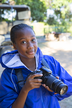 Pupil Evelyn Lekanyane with DSLR camera during residential photography course organised by Wild Shots Outreach. Kruger National Park, South Africa, June 2017.