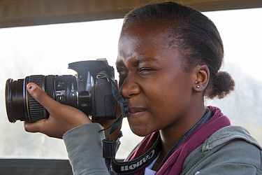 Pupil Evelyn Lekanyane with camera during residential photography course organised by Wild Shots Outreach. Kruger National Park, South Africa, June 2017.