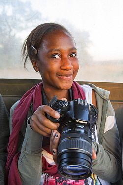 Pupil Evelyn Lekanyane with camera during residential photography course organised by Wild Shots Outreach. Kruger National Park, South Africa, June 2017,
