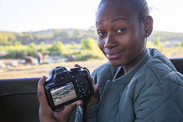 Pupil Prisence Mashaba showing the photo she has just taken on the back of her camera, during residential photography course organised by Wild Shots Outreach. Kruger National Park, South Africa, June.