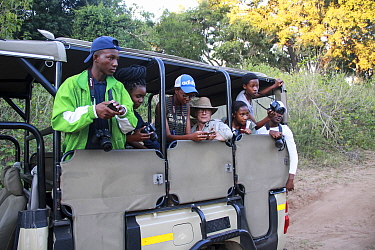 Students taking pictures during residential photography course organised by Wild Shots Outreach. Kruger National Park, South Africa, June.