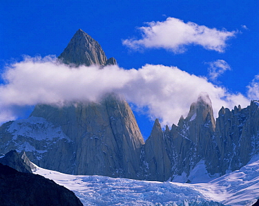 Clouds forming aroung the jagged summit of Mount Fitz Roy (Chalten) over Piedras Blancas glacier, in Glaciers National Park, Argentina