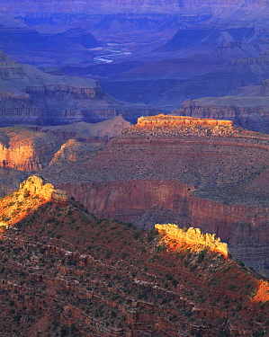 Jagged buttes catch the last light as the sun sets at Grandview Point, Grand Canyon National Park, Arizona