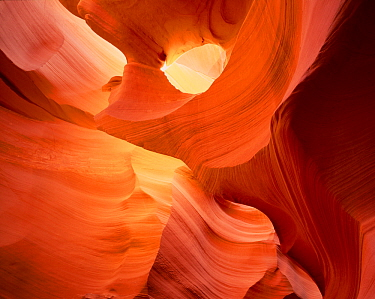 Antelope Canyon, a slot canyon with eroded sandstone patterns and rays of sunlight filtering in, Navajo Reservation, Arizona, USA