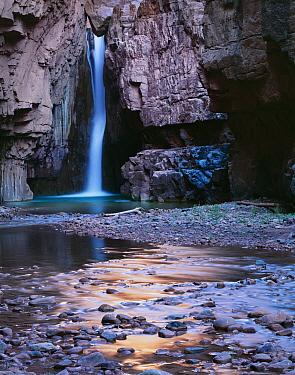 Cibecue Creek waterfall pouring through canyon narrows, White Mountain Apache Reservation, Arizona, USA