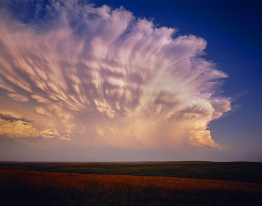 Cheyenne River Sioux Tribal Park with severe storm clouds at sunset amid vast grassland, South Dakota, USA