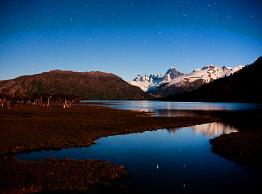 Cerro Azul, Krueger Peak, Cerro Mellizo, in starlight reflections in Rio Pasqu flowing from Lago O'Higgins, Aisen Province, Chile