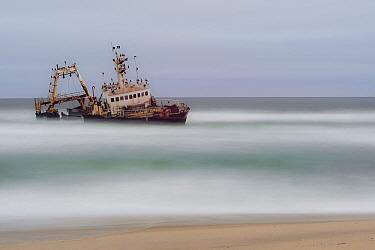 Wrecked ship with cormorant colony, on Namibia's skeleton coast, Dorob National Park, Namibia. July 2013.