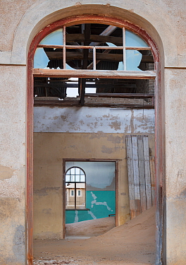 Abandoned homes in the diamond mining ghost town. Kolmanskop, near the Skeleton Coast, Namibia. June 2013.