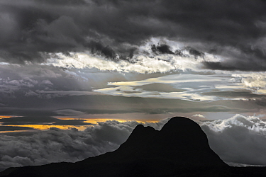 The mountain Suilven silhouetted against sunset with storm clouds, Inverpolly National Nature Reserve, Sutherland, Scottish Highlands, Scotland, UK, September 2016.