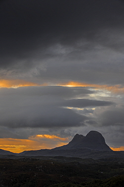Rain clouds over the mountain Suilven,  Inverpolly National Nature Reserve, Sutherland, Scottish Highlands, Scotland, UK, September 2016.