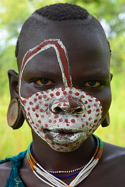 Young Suri / Surma woman with painted face. Omo river Valley, Ethiopia, September 2014.
