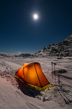 Winter camping in mountains with moonrise above, near Ben Cruachan and Stob Diamh, Southern Highlands, Scotland, UK, February 2017.