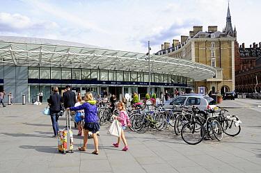 Passengers walking towards Kings Cross train station, London, England, Britain, UK, August 2014.