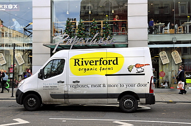 Riverford Organic Farms Van on its way to deliver veg / vegetable boxes, Tottenham Court Road, Central London England, UK, December 2013,