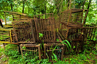 Disused, rusty cages used for Moon bears (Ursus thibetanus) from a bear bile farm. Bile is extracted from the bears' livers to be used in traditional Chinese medicine, China. September 2011.