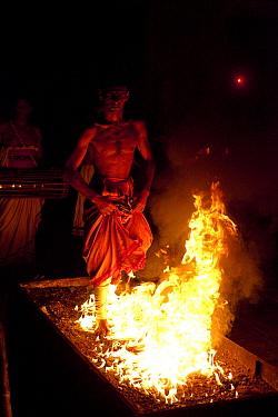 Man firewalking during festival, Kandy, Sri Lanka, December 2012.
