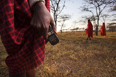 Mobile phone in  hand of Maasai man, Mara region, Kenya, September 2013.