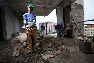 Economic migrant from rural areas working on construction site, Nairobi, Kenya, November 2013.