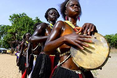 Carnival procession led by drummer, Eticoga, Orango Island, Bijagos UNESCO Biosphere Reserve, Guinea Bissau, February 2015.