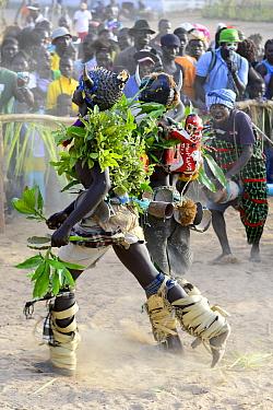 Dancers and spectators at carnival, Eticoga, Orango Island, Bijagos UNESCO Biosphere Reserve, Guinea Bissau, February 2015.