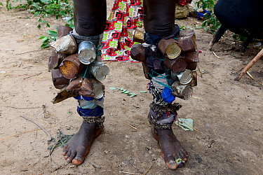 Legs of participant in carnival, covered with tin cans, Eticoga, Orango Island, Bijagos UNESCO Biosphere Reserve, Guinea Bissau, February 2015.