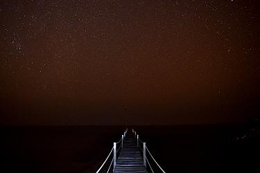 Starry night over Atlantic Ocean taken from a wooden pier, Orango Island, Bijagos UNESCO Biosphere Reserve, Guinea Bissau, February 2015.