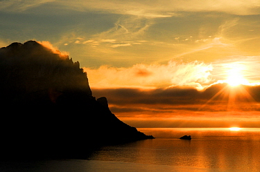 Islet of Es Vedr�, at sunset,  Ibiza, Biodiversity and Culture UNESCO World Heritage Site, Ibiza, Spain, February 2008.