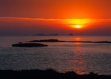 Sunset over  the Mediterranean Sea with Bledes islands, from Compte beach, Ibiza biodiversity and culture UNESCO World Heritage Site, Spain.
