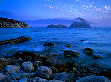 Es Vedranell and es Vedra' islands seen at dusk from Cala d'Hort, Ibiza, biodiversity and culture UNESCO World Heritage Site,  Spain.
