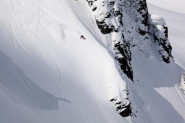 Snowboarder descending Table Mountain in the Heather Meadows Recreation Area, Washington, USA. March 2013.