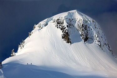 Snowboarders below Table Mountain in the Mount Baker Wilderness, Washington, USA. March 2013.