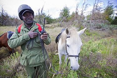 Wildlife poaching patrol unit on horseback give radio update, Mount Kenya National Park, Kenya