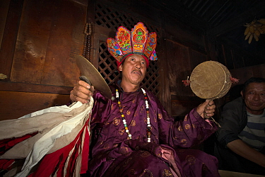 Naxi shaman performing ceremony, Yunnan, China, July 2010.