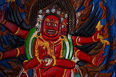 Painting of a wrathful deity in Lama Buddhist temple in Wenquan town, Tibetan Plateau, Qinghai, China
