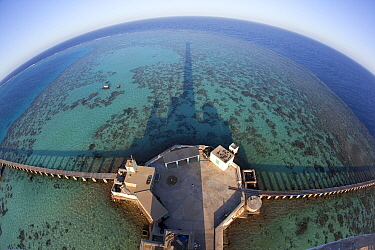 Panoramic view of reef and pier from Lighthouse, Sanganeb Reef, Sudan, Red Sea. May 2011.