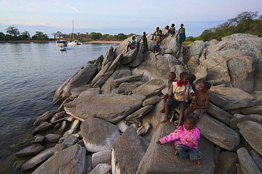 Children of a nearby fishing village on the shore of Lake Malawi, , Malawi. November 2015. Photographed for The Freshwater Project.