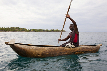 Fisherman in traditional dugout canoe, Lake Malawi,  Malawi, November 2015. Photographed for The Freshwater Project