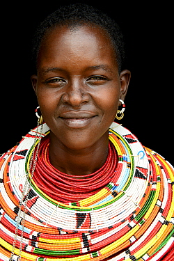 Samburu woman with her traditional coloured necklaces, head portrait, near Samburu National Reserve, Kenya. September 2017.