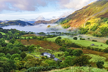 Early morning mist in the Gwynant Valley looking south west over Llynn Gwynant, Snowdonia National Park, North Wales, UK, September 2017