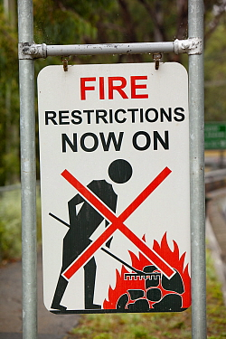 Fire restriction sign near Kinglake, one of the communities worst affected by the catastrophic 2009 Australian Bush Fires in the state of Victoria in which 173 people were killed. Victoria, Australia....
