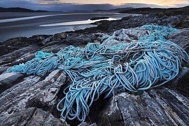 Discarded plastic rope and commercial fishing netting washed up on shore at Luskentyre, South West Harris, Western Isles / Outer Hebrides, Scotland, May 2016