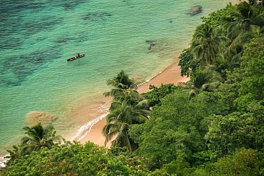 Fisherman with typical pirogue off the shore of Boi Beach and Macaco beach, Principe Island UNESCO Biosphere Reserve, Democratic Republic of Sao Tome and Principe, Gulf of Guinea.