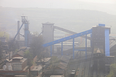 Smog over the pit head of a coal mine near Tongshuan. Shanxi Province, China, March 2009.